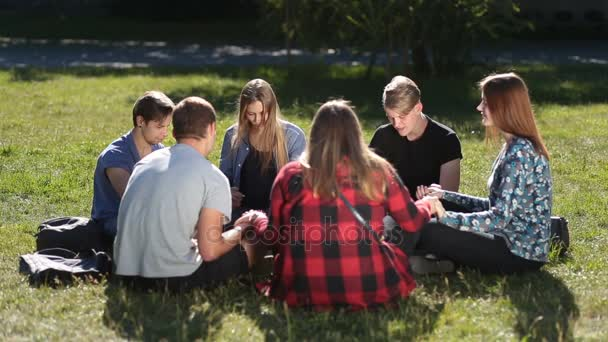 depositphotos_156919188-stock-video-young-christians-sitting-in-circle
