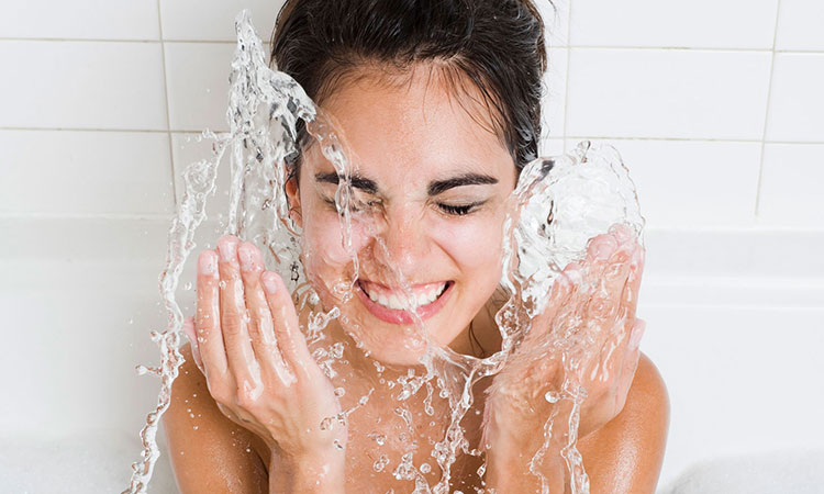 Woman-splashing-water-on-face-2